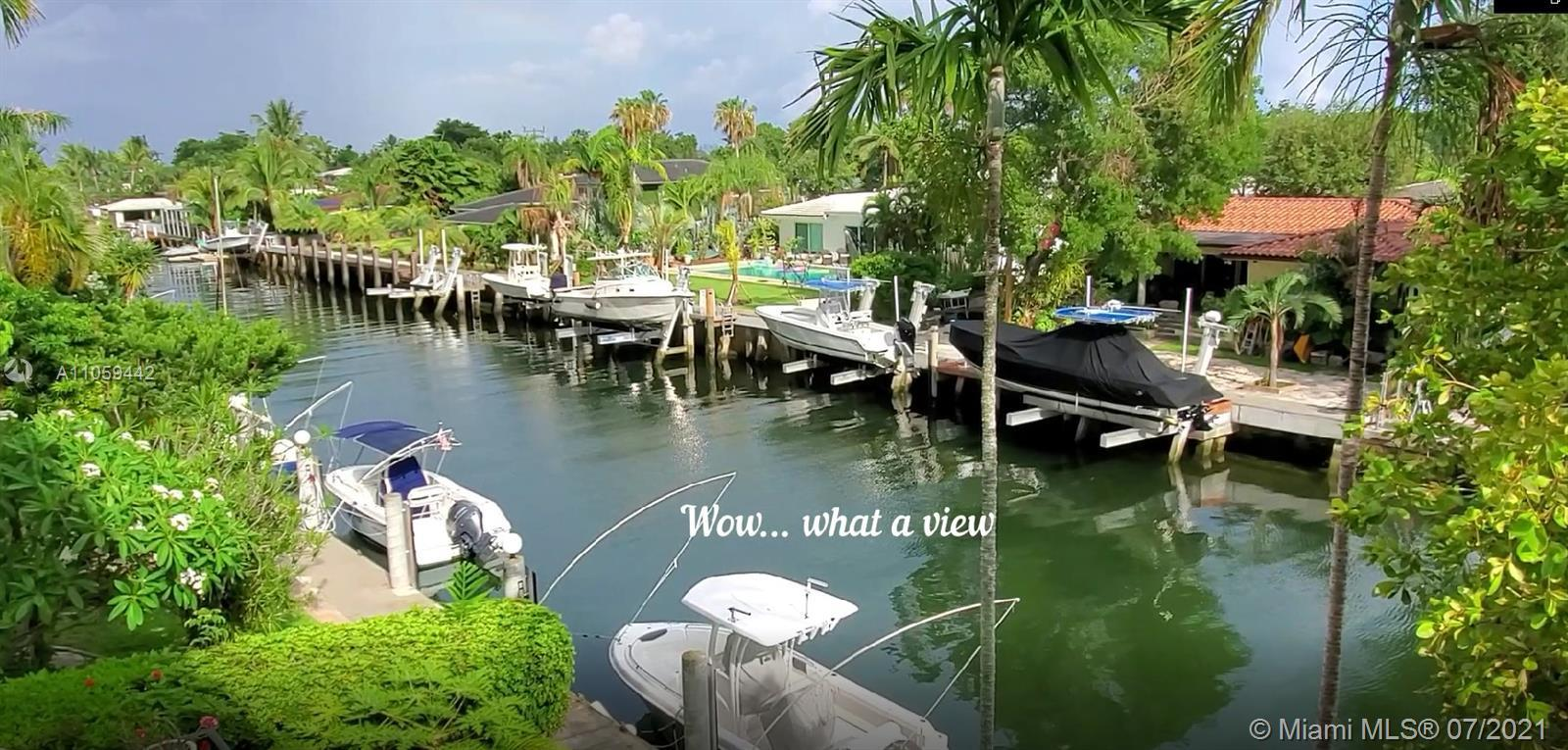 Amazing! Lovely 2/3 Waterfront Miami Shores TH. Boaters will love the fact that this TH has a boat
