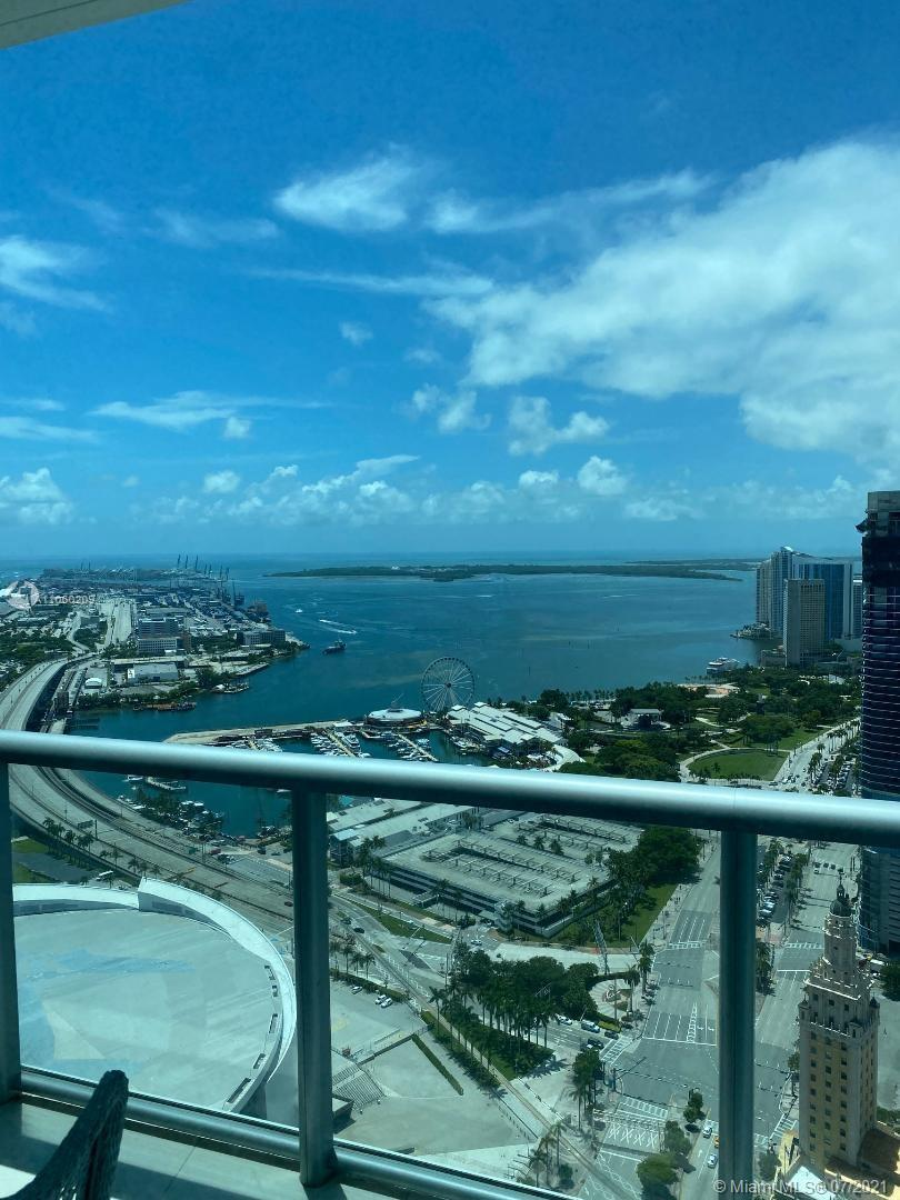 Rarely available south east corner unit at the Marina Blue with spectacular views of the bay and Mia