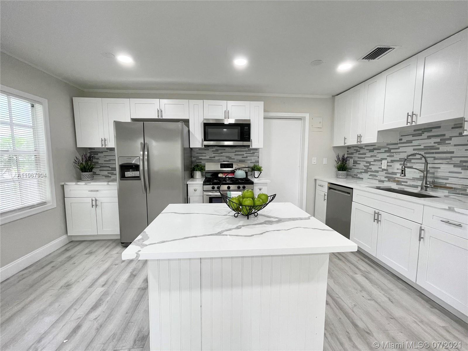 Beautifully remodeled 2 Bedroom/ 2 Bath single family home in Northwood Village. Enjoy easy access t