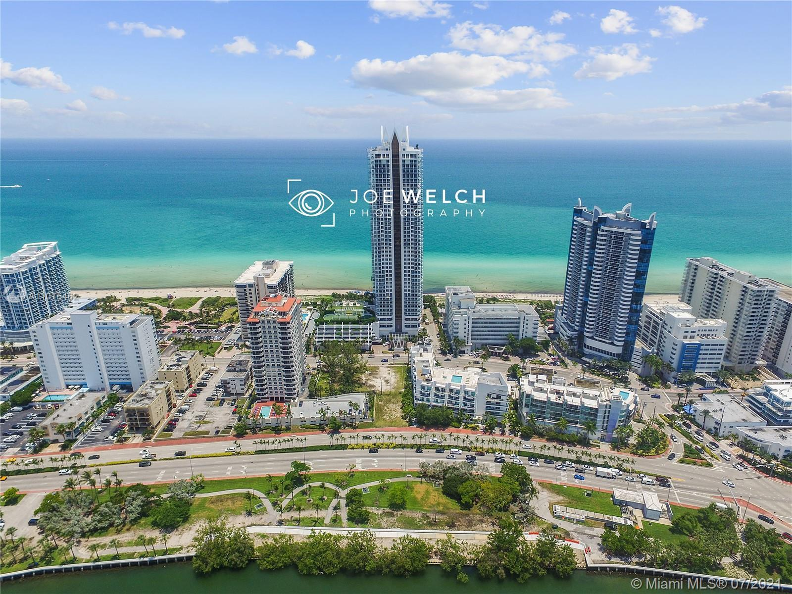 Breathtaking, elegantly renovated unit at the beautiful Akoya beachfront building with ocean, bay an