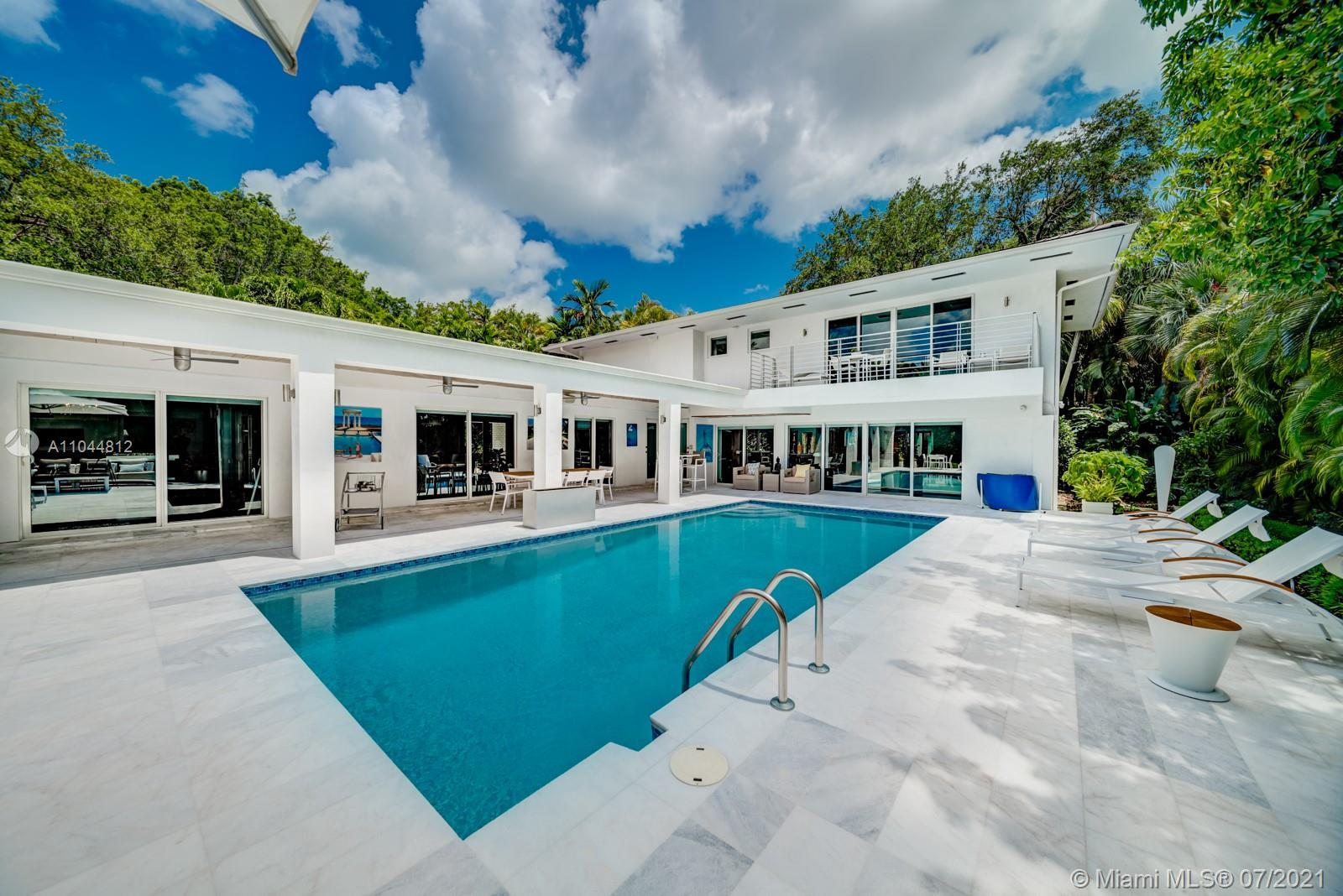 Flawless contemporary 4/3 pool home in Bay Point Estates w/magnificent Zen garden & koi pond poi are