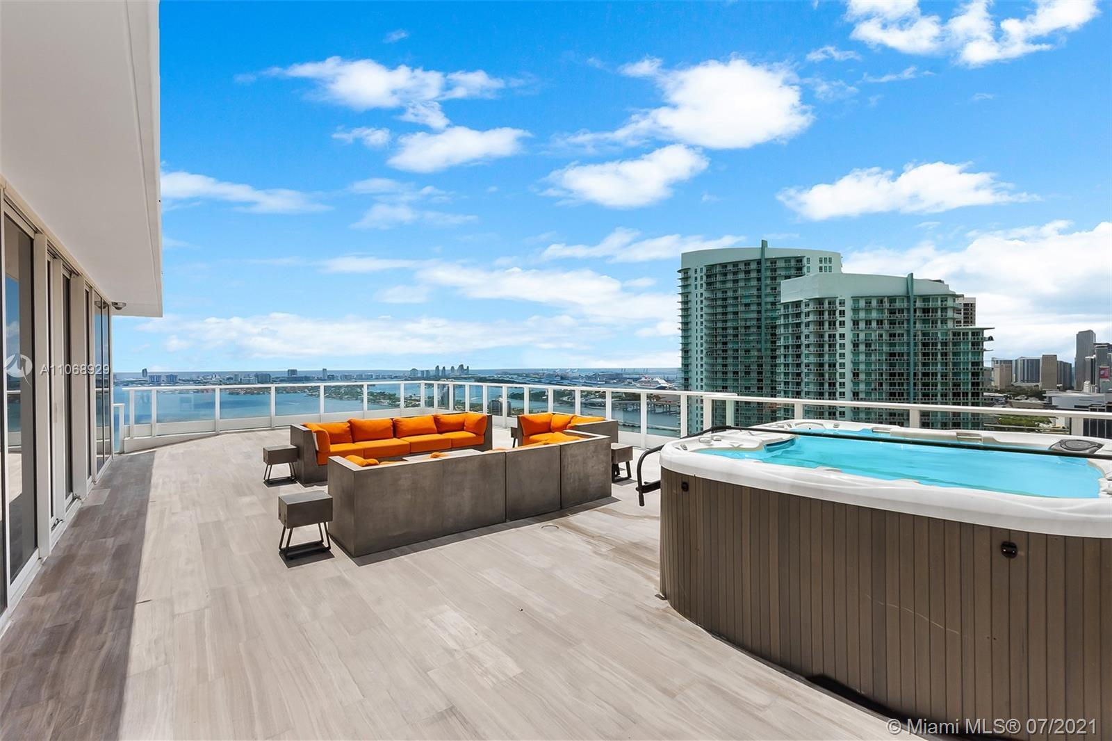 Welcome to PH1 - This exquisitely designed and turnkey furnished condo offers an impressive 180 degr