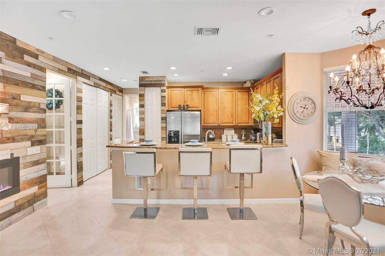 This rare, spacious, and pristine 4/4 townhouse located a prime location within Boynton Beach will n