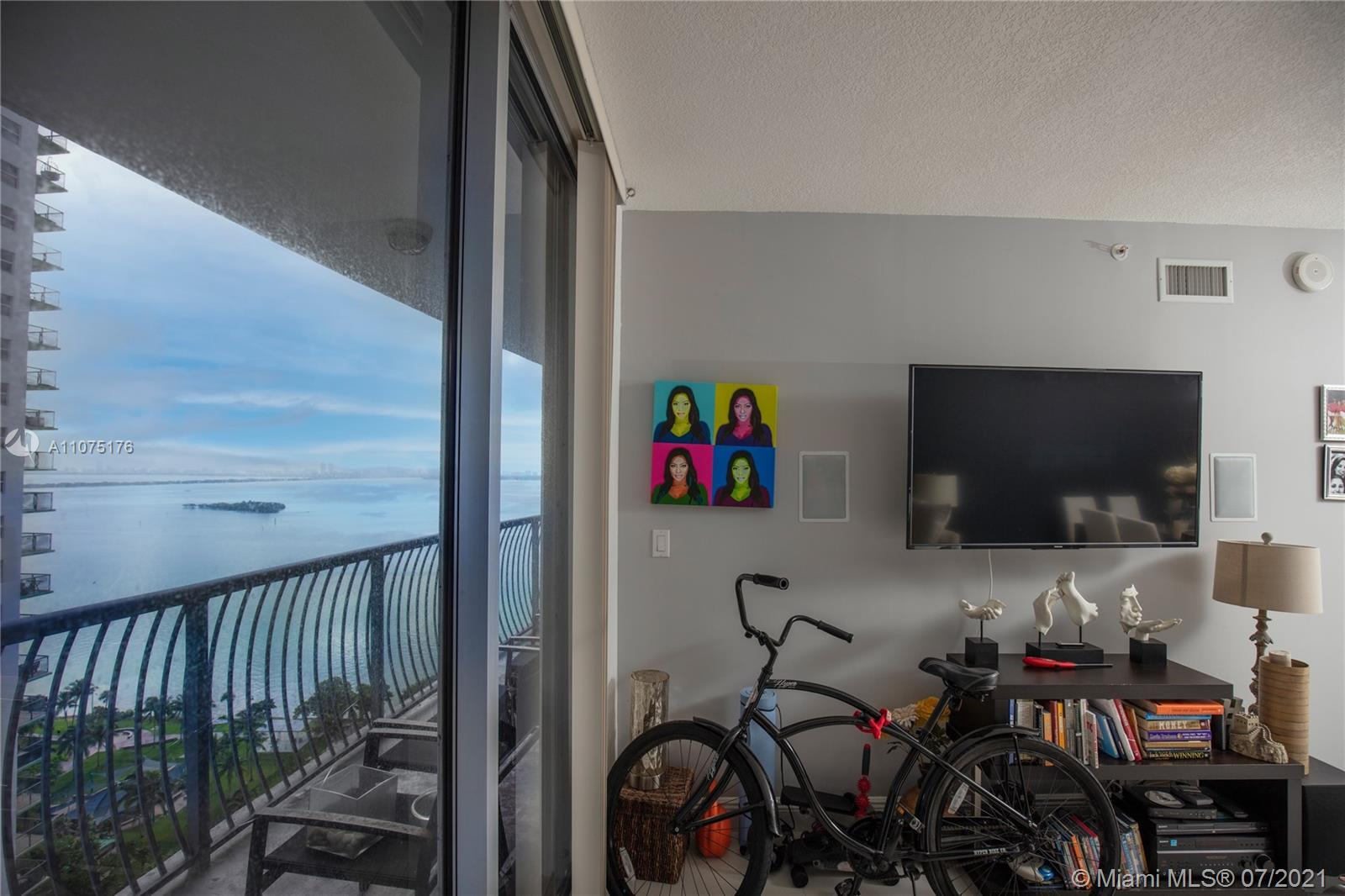Amazing bay and city views from this unit with a large balcony and great layout.  The kitchen is ope
