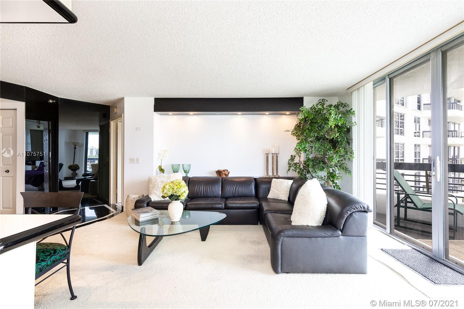 Well decorated corner unit located in a prestigious gated community with lobby concierge 24/7 valet