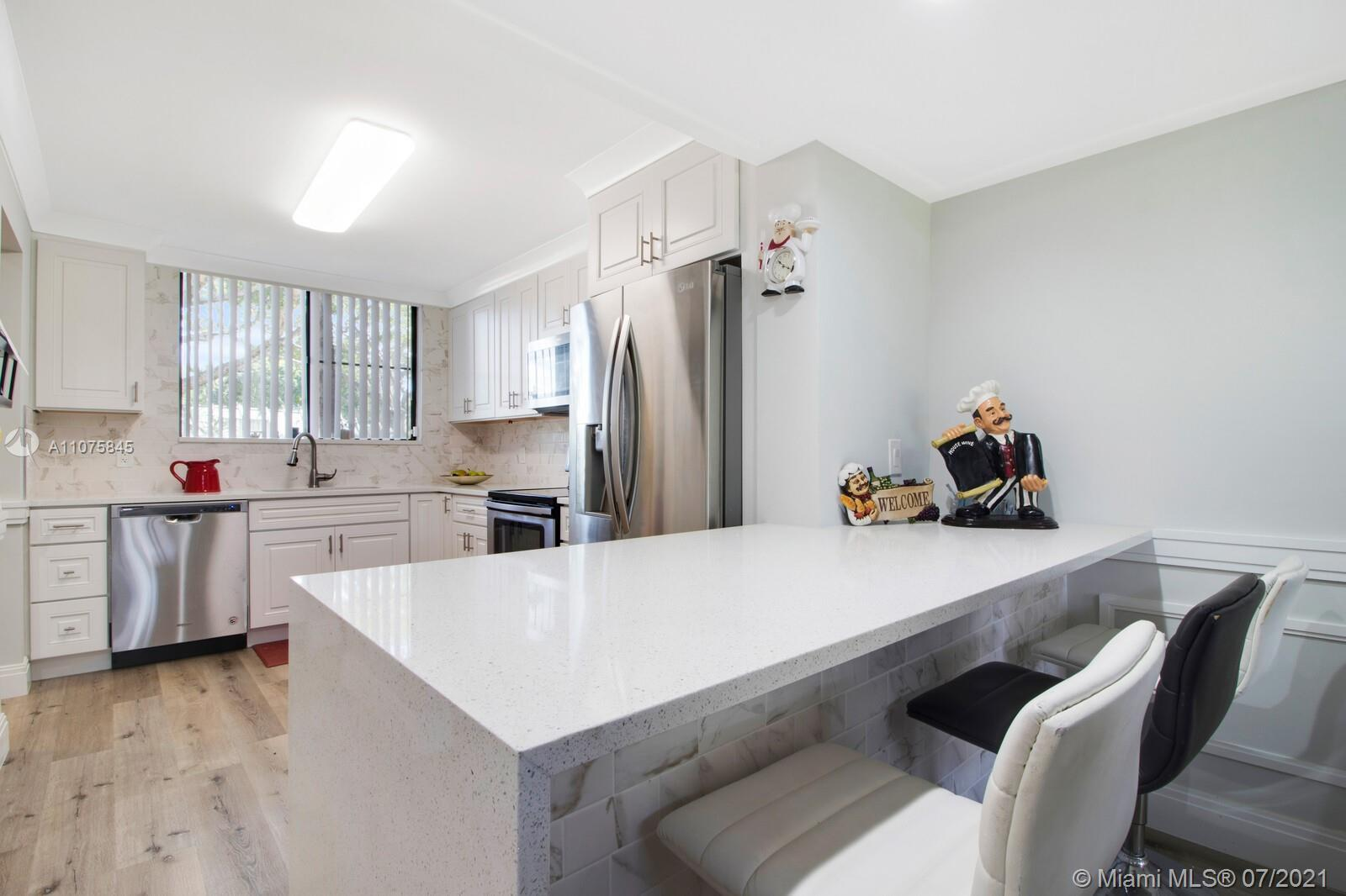 This unique cozy and homey townhouse is  corner unit, with a beautiful garden view, impacted windows