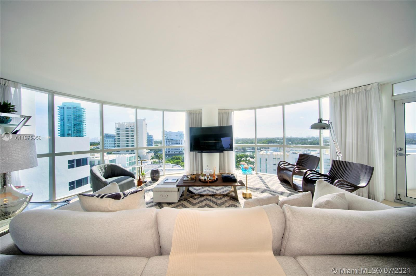 Spectacular 180-degree views of the ocean, bay and Miami skyline from floor to ceiling windows.  Th