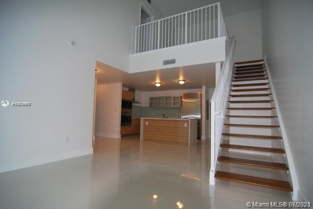 Spectacular 2 bedroom townhouse in the most luxurious & prestigious building in Edgewater. Enjoy the