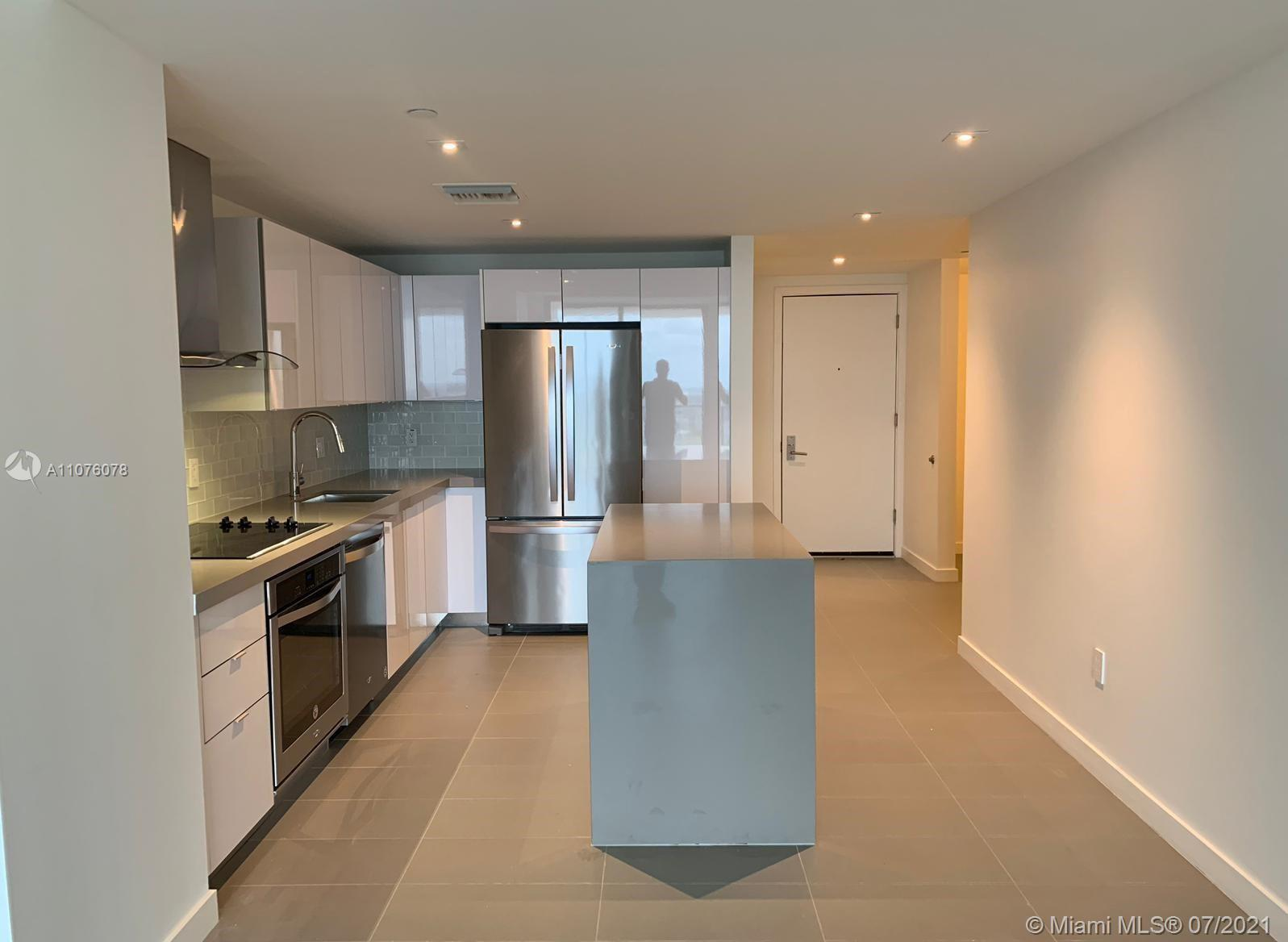 Very spacious 1 bed 1.5 baths with a den on the last floor in the A&E District. Incredible sunset vi
