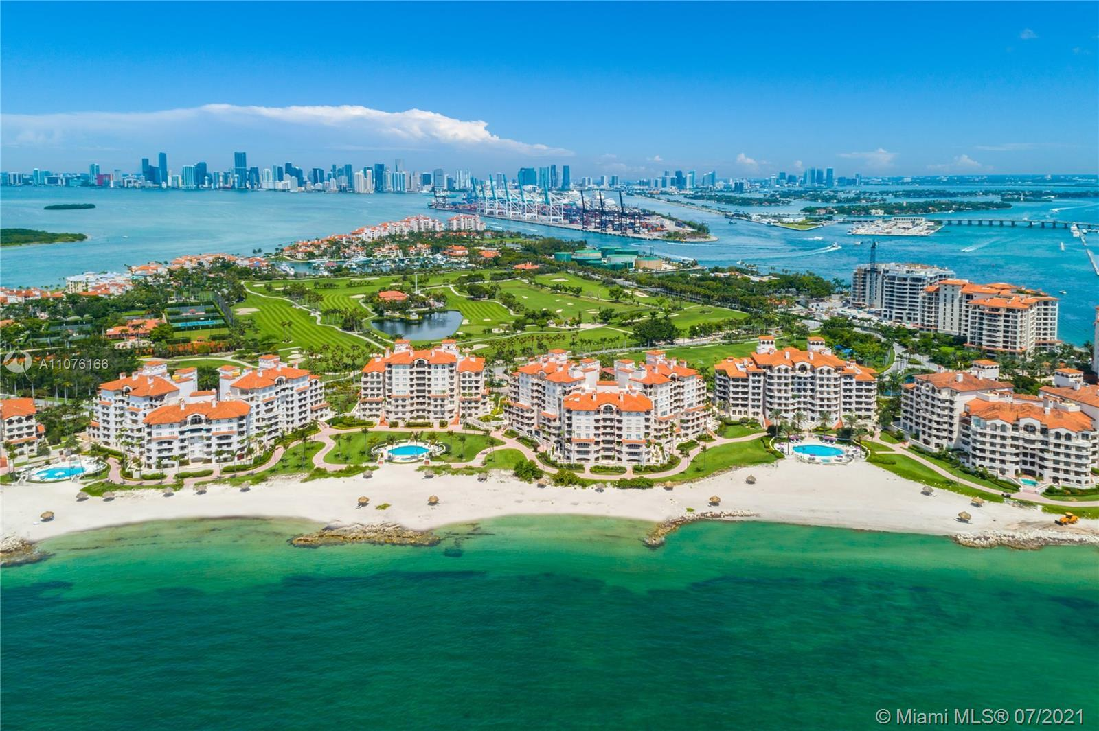 This stunning center-stack Oceanside unit redefines luxury living at its finest. Located in one of t
