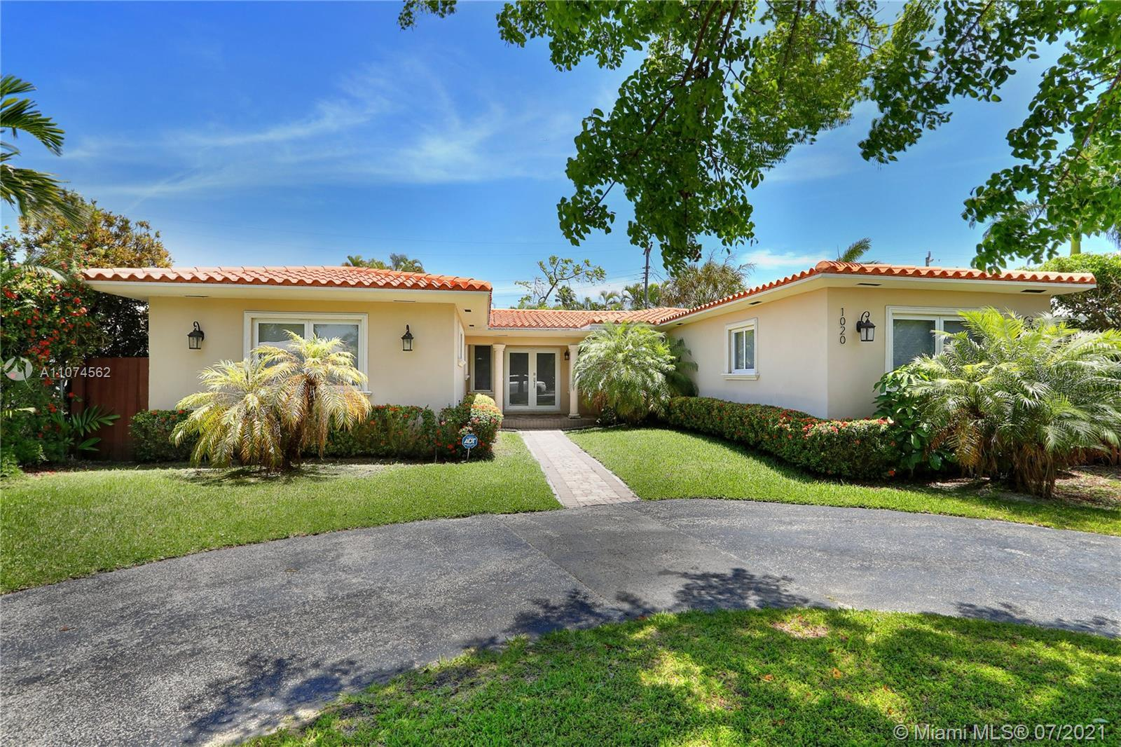 Located in gated Normandy Shores Island & near the Beach & Normandy Shore's Golf Club, this home has