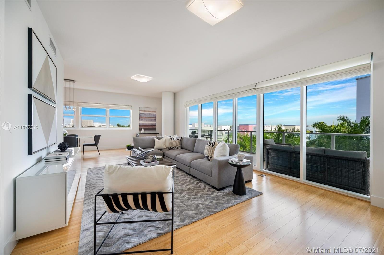 Situated within the lush Aqua community on Allison Island, this waterfront condo offers an elegant r