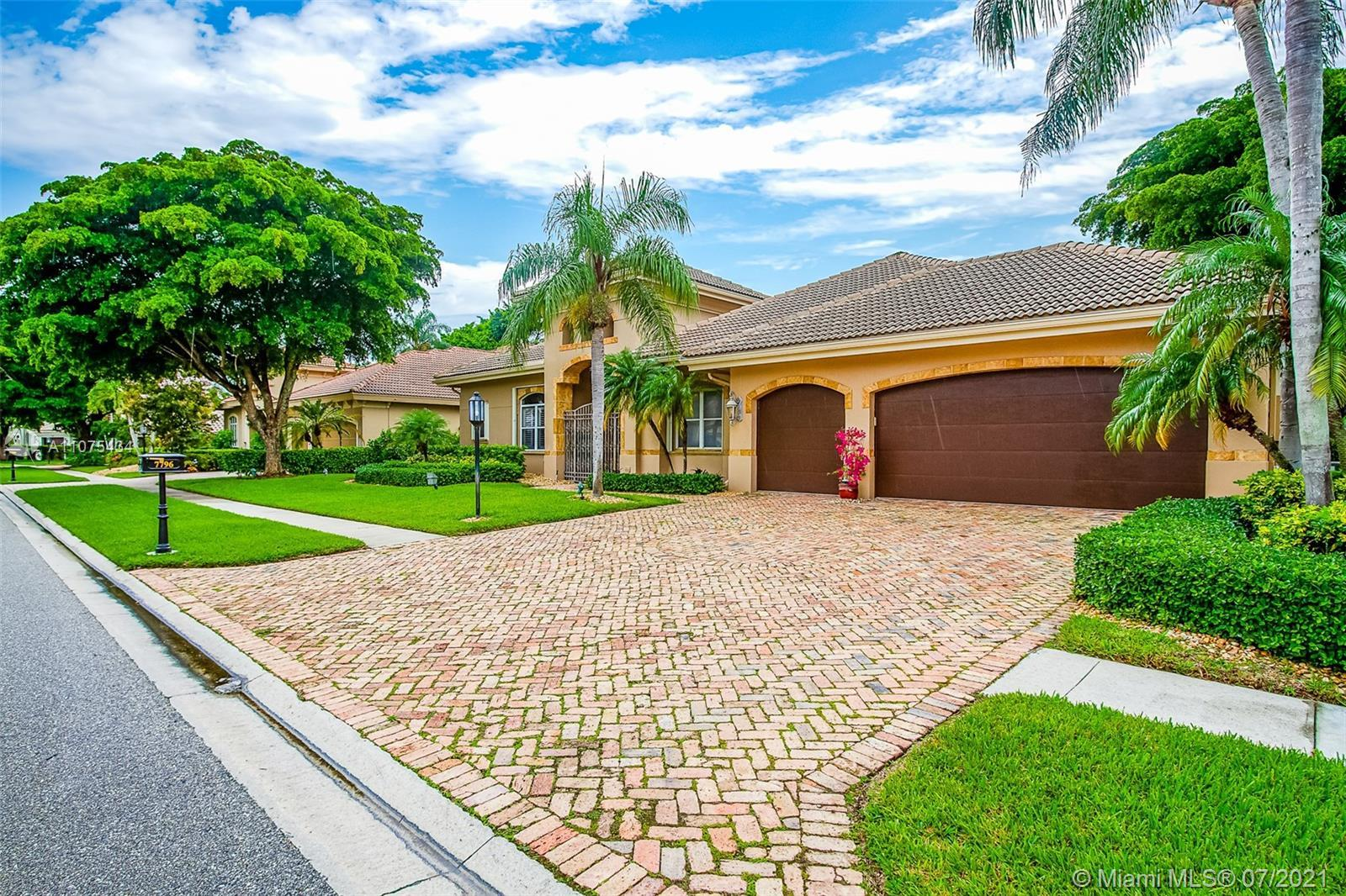 Beautiful Mediterranean Style 4 bedroom 3.5 bath Pool Home located on the 7th Fairway at Boca Grove