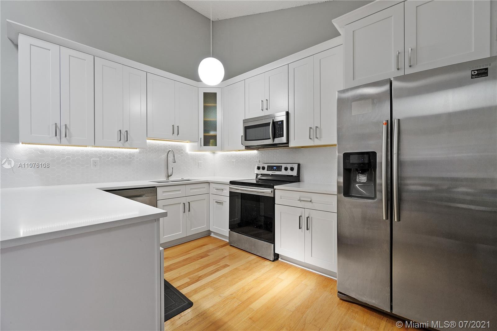 Beautifully remodeled 3 bed 3.5  bath townhome with private screened in patio in fabulous Boca Garde