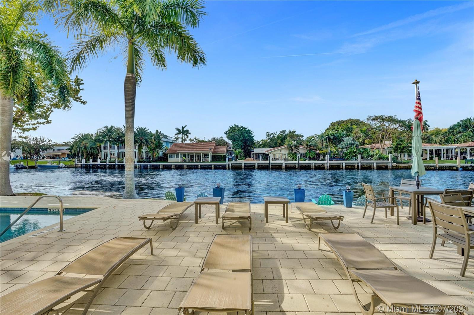 Experience the South Florida lifestyle at its best, in this home located directly on the New River o