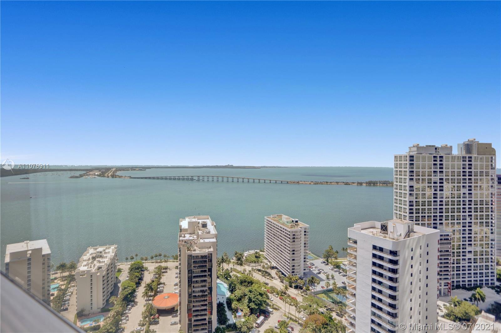 LEGENDARY FOUR SEASONS CONDO- HOTEL STUDIO UNIT WITH BEST SOUTH UNOBSTRUCTED VIEW OF THE BAY AND KEY