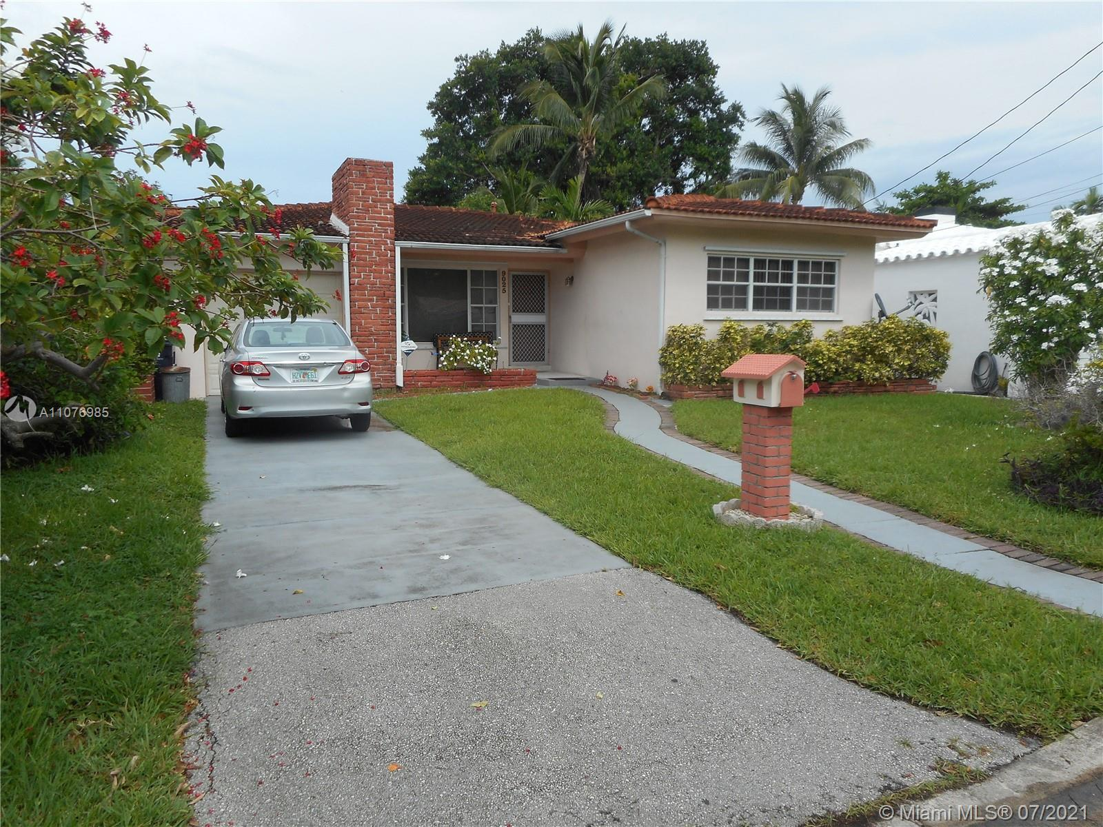 Three Bedroom 2 Bath with Garage. One of the best streets in Surfside right across from the park and