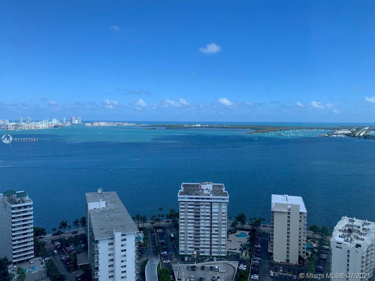 LUXURIOUS FOUR SEASONS FURNISHED 2 BED/2 BATH CORNER UNIT WITH UNOBSTRUCTED VIEWS OF THE BAY, OCEAN