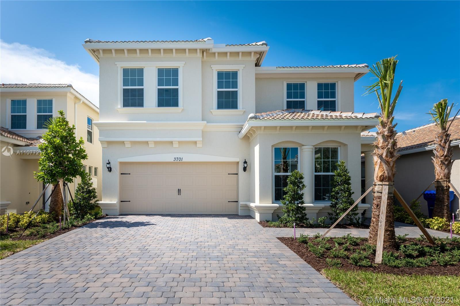 Impeccable 2021 construction home in Hollywood! Located in a desirable gated community, this two-sto