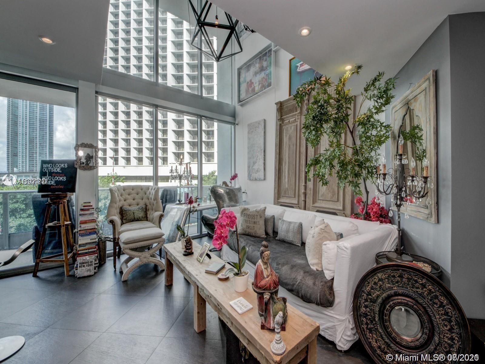 Downtown Miami's most prestigious address Beautiful, artistically decorated 2 story loft Floor to ce