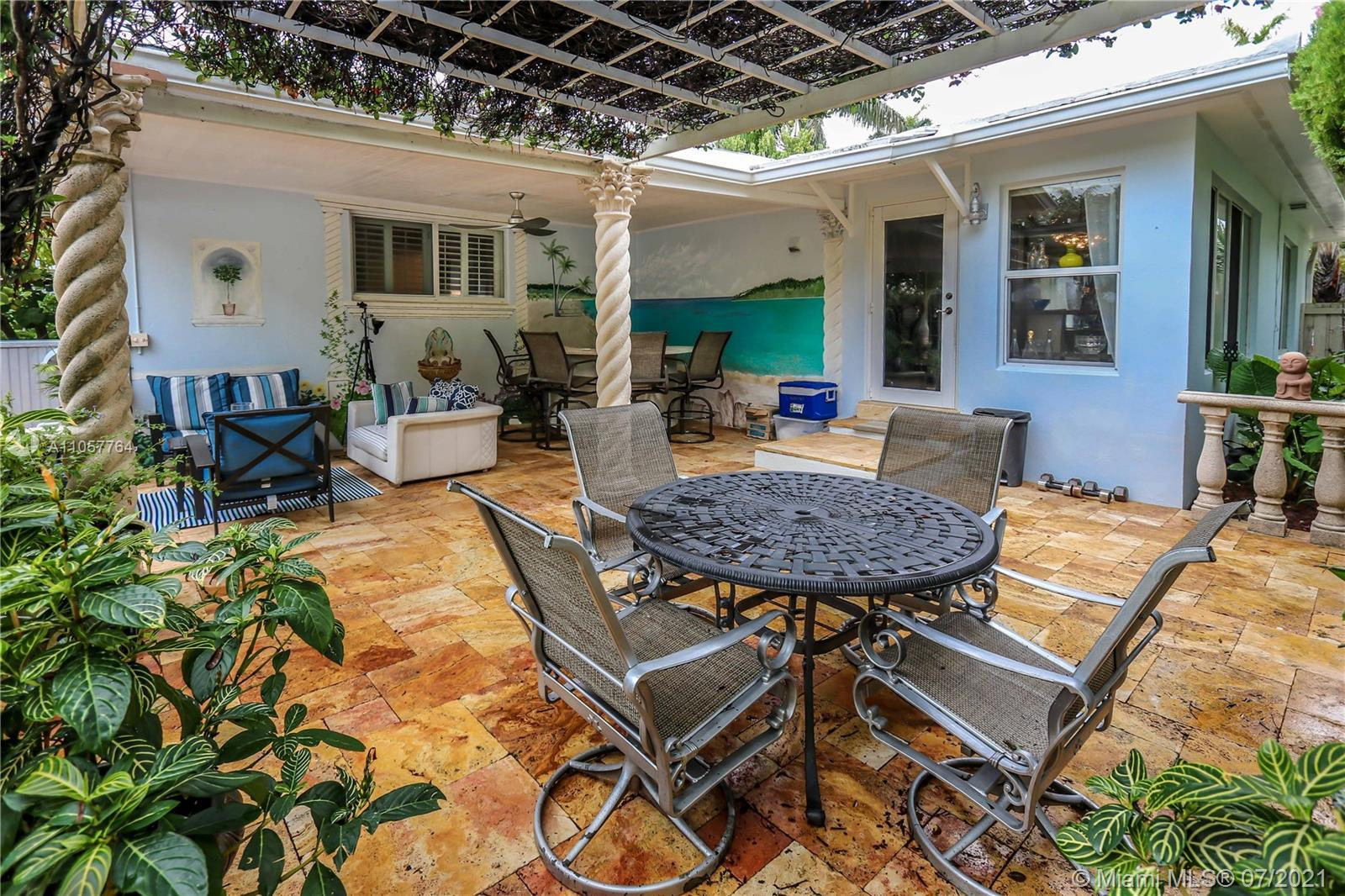 Impeccable, Bright, spacious Fully updated 1747sf, 3/2 Pool home is a very private retreat tropical