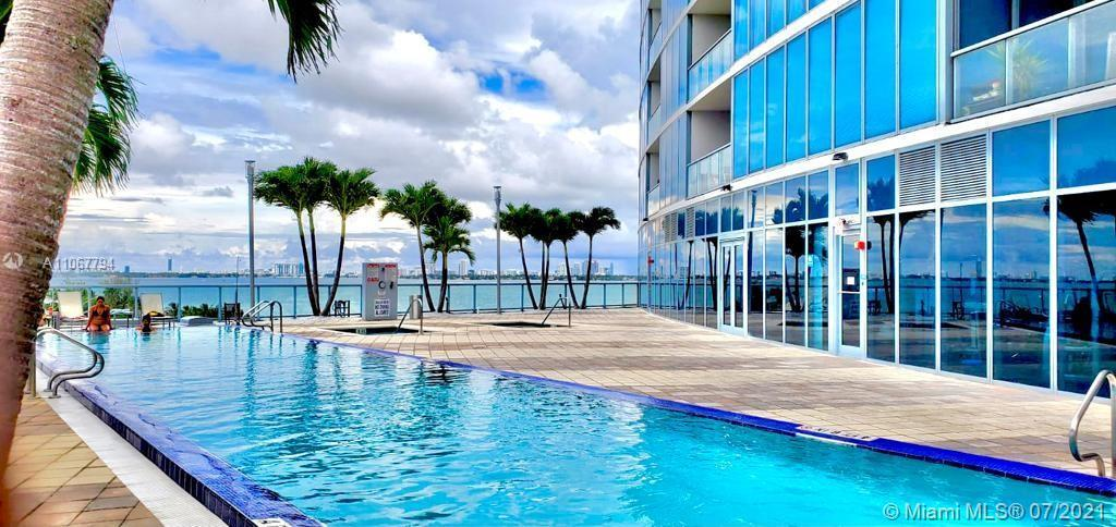 PRICED TO SELL. This 2 bedroom 2 and half condo not only has an amazing northeast view of the Intrac