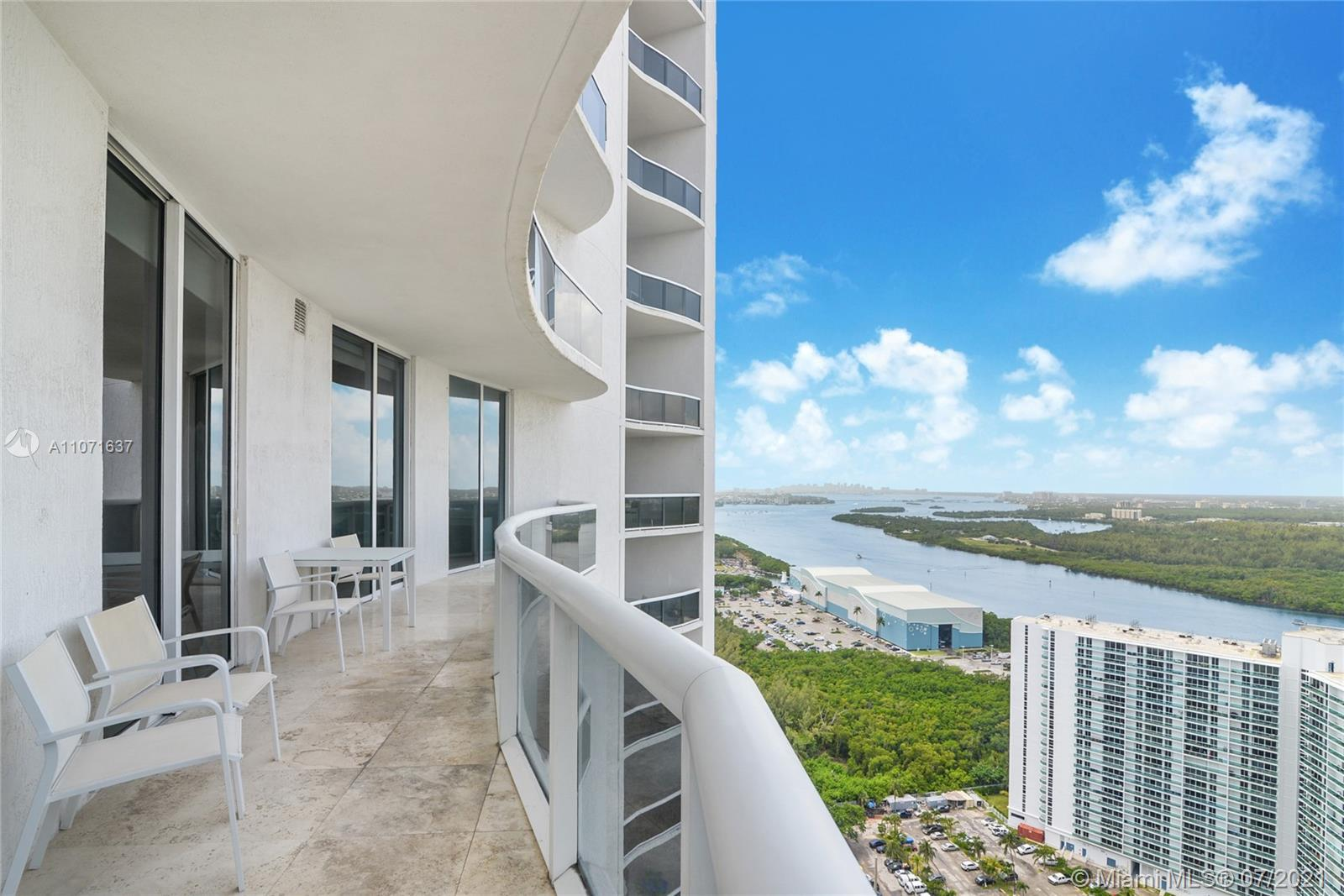 Enclaved on the white sands of Sunny Isles Beach, this property offers floor to ceiling sliding glas