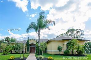 This wonderful 3/2 home is settle on 1.79 acres with a 15 minutes commute to Palm Beach Internationa