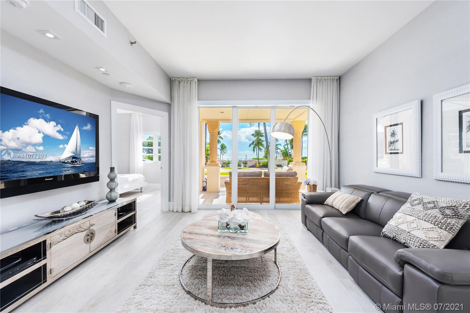 Experience Fisher Island living at its finest in this beautifully renovated 3 bedroom, 3.5 bath grou