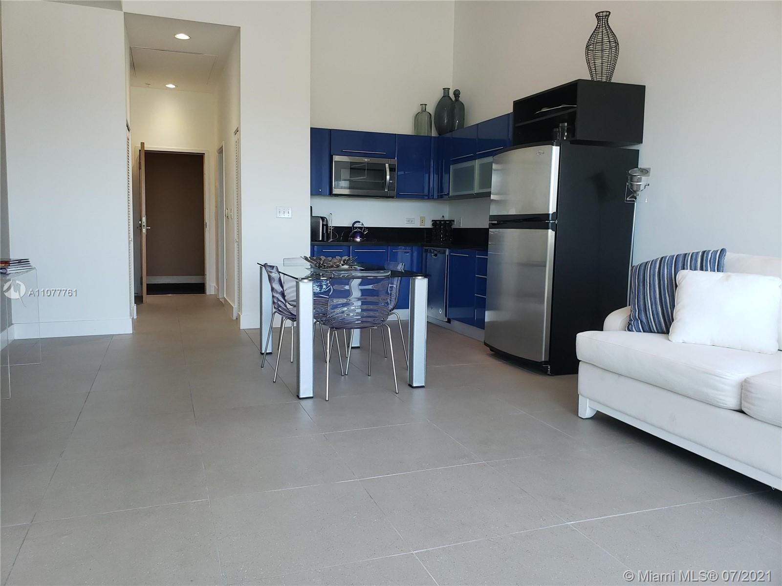 VERY NICE FURNISHED STUDIO at Vizcayne building; high ceiling, amazing blue kitchen, direct bay side