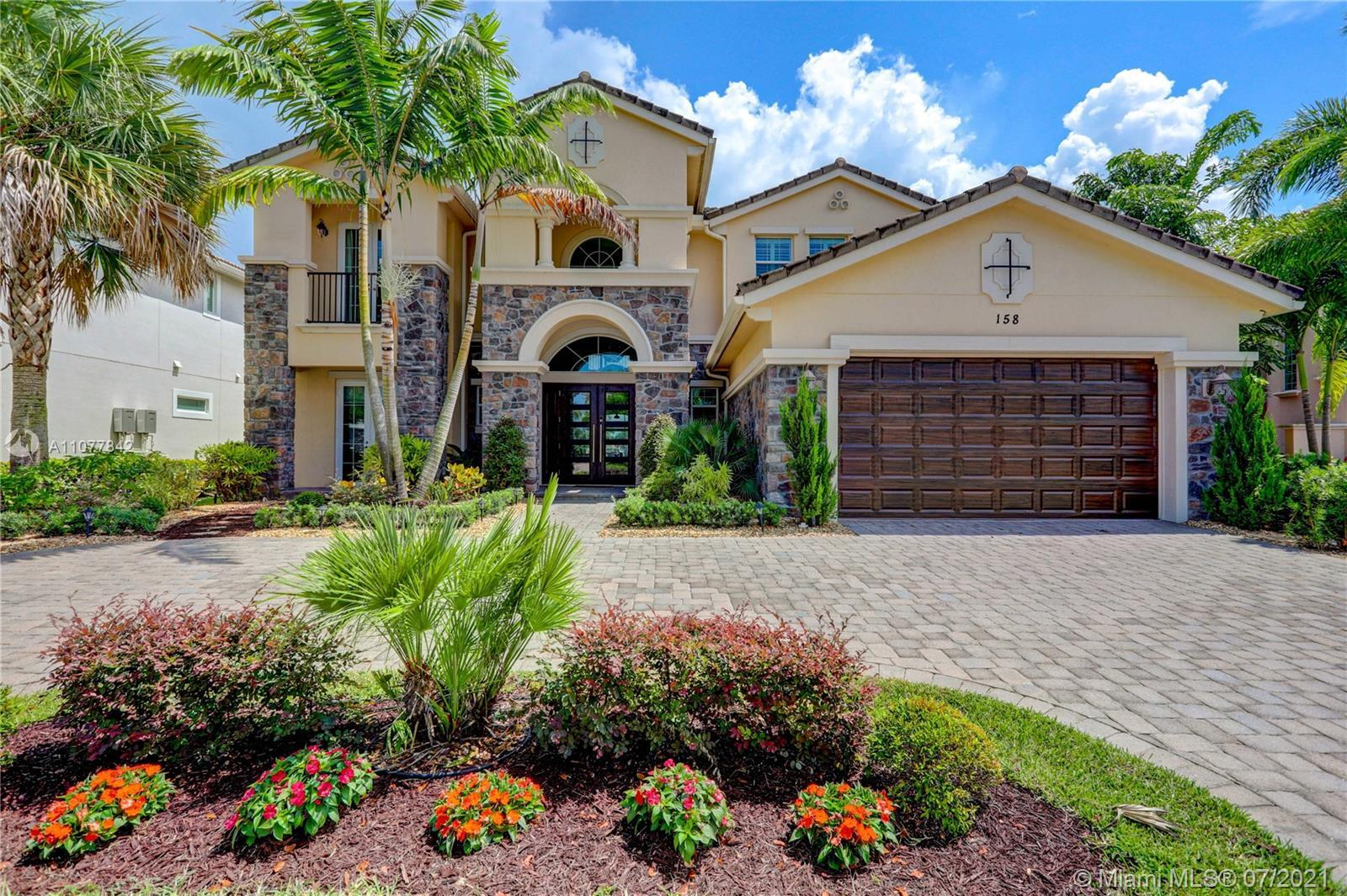 Enjoy the splendor of this fabulous home In Jupiter Country Club.  6 BR expanded model offers over 5