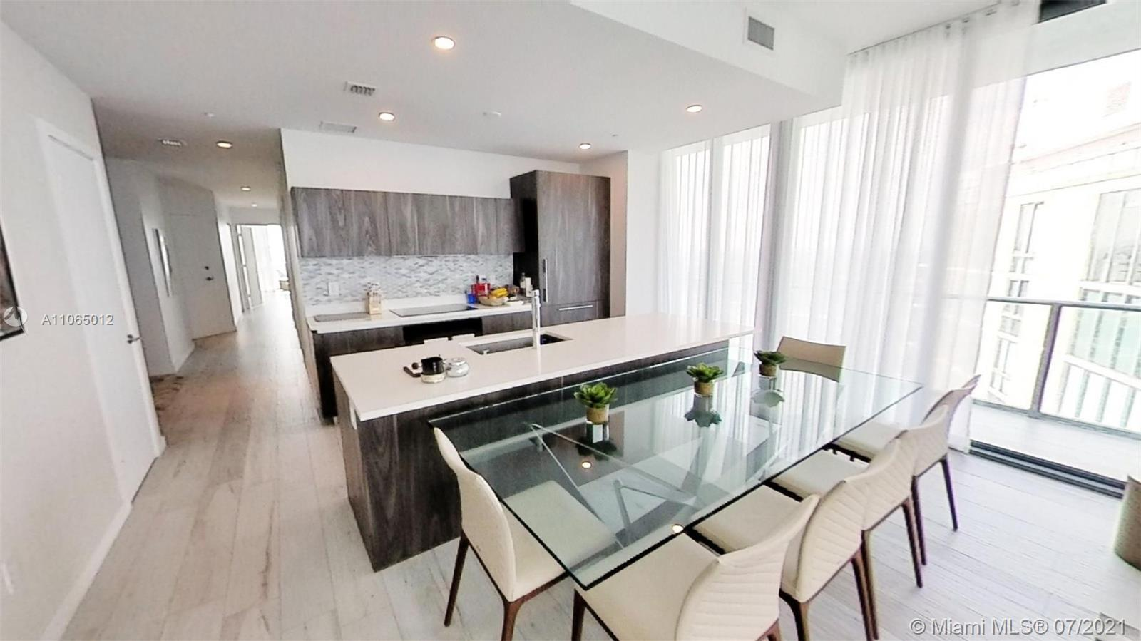 Amazing lower Penthouse corner unit with 3 bedrooms , 3 baths and 2 parking spaces with the best vie