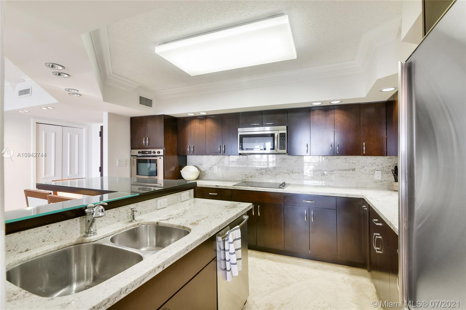 One of a kind. Completely remodeled and redesigned floorplan. Turn Key. Modern open kitchen with Bos