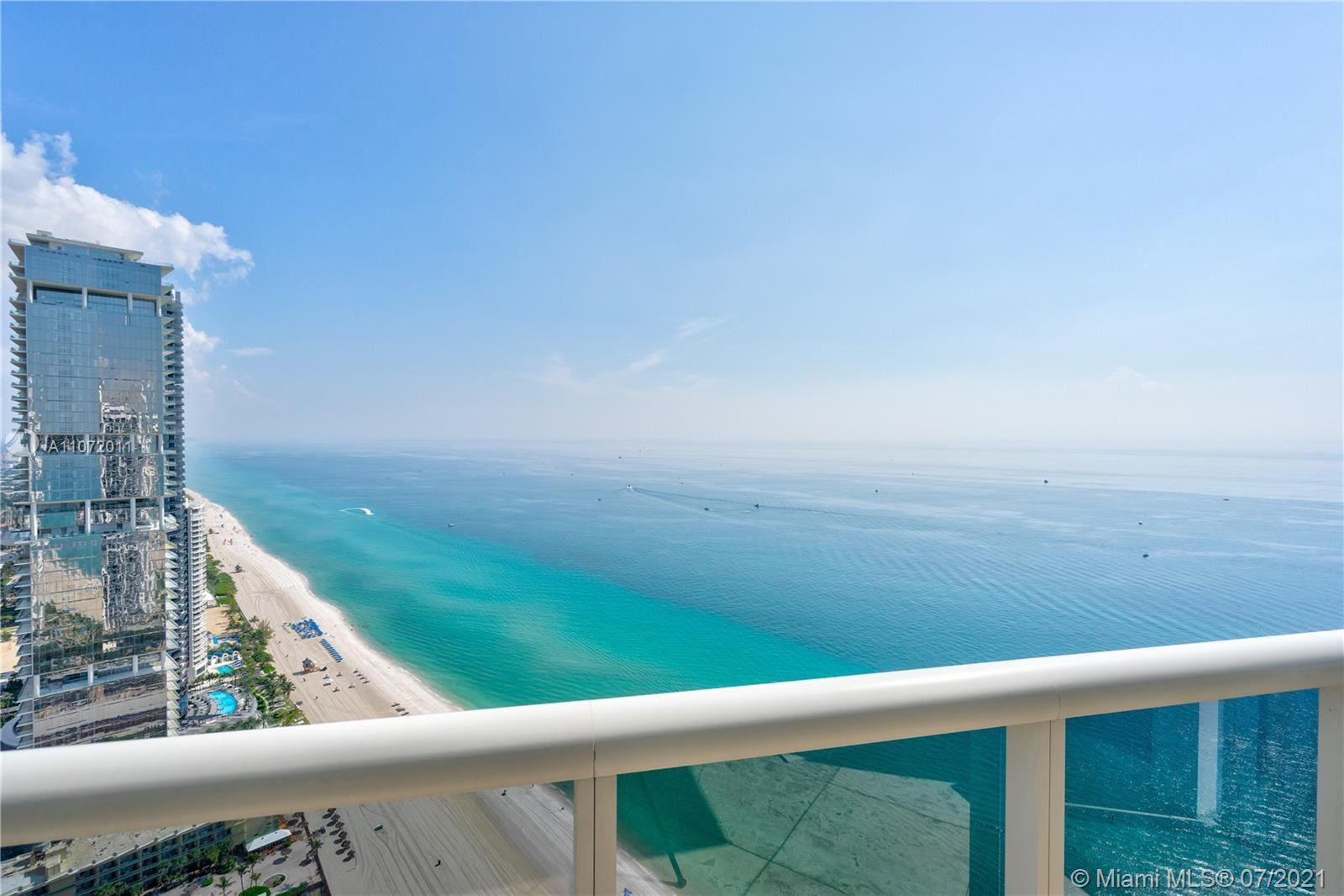 Beautiful and unique condo with ocean views and marble floors throughout. 2 bedrooms + Den / 3 Bathr