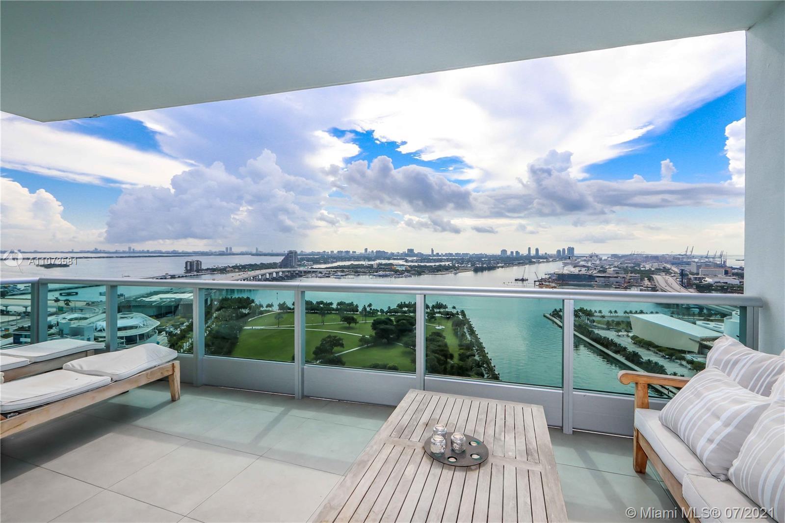 Showroom-quality furnished 1 Bed+Den/2 Bath condo at the luxurious 900 Biscayne Bay w/ porcelain til