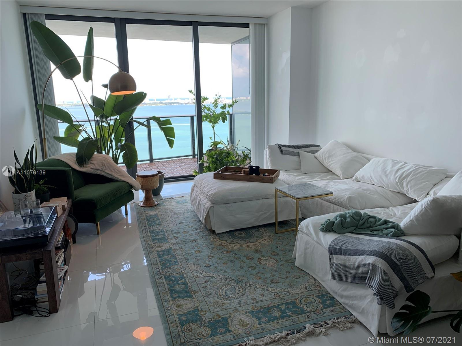 Beautiful bay views from this 2 bedroom PLUS a DEN unit at Icon Bay.