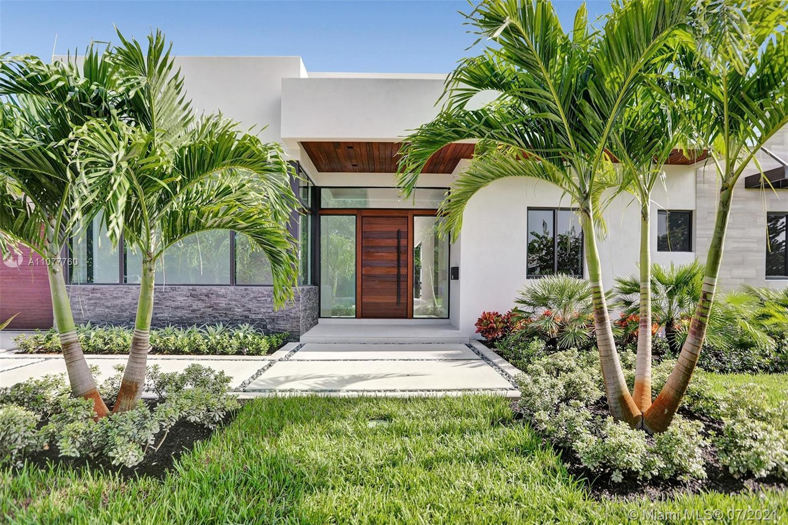 100 FEET ON THE WATER IN CORAL RIDGE! Architecture designed by Steve Brandt, Design includes a 4 bed