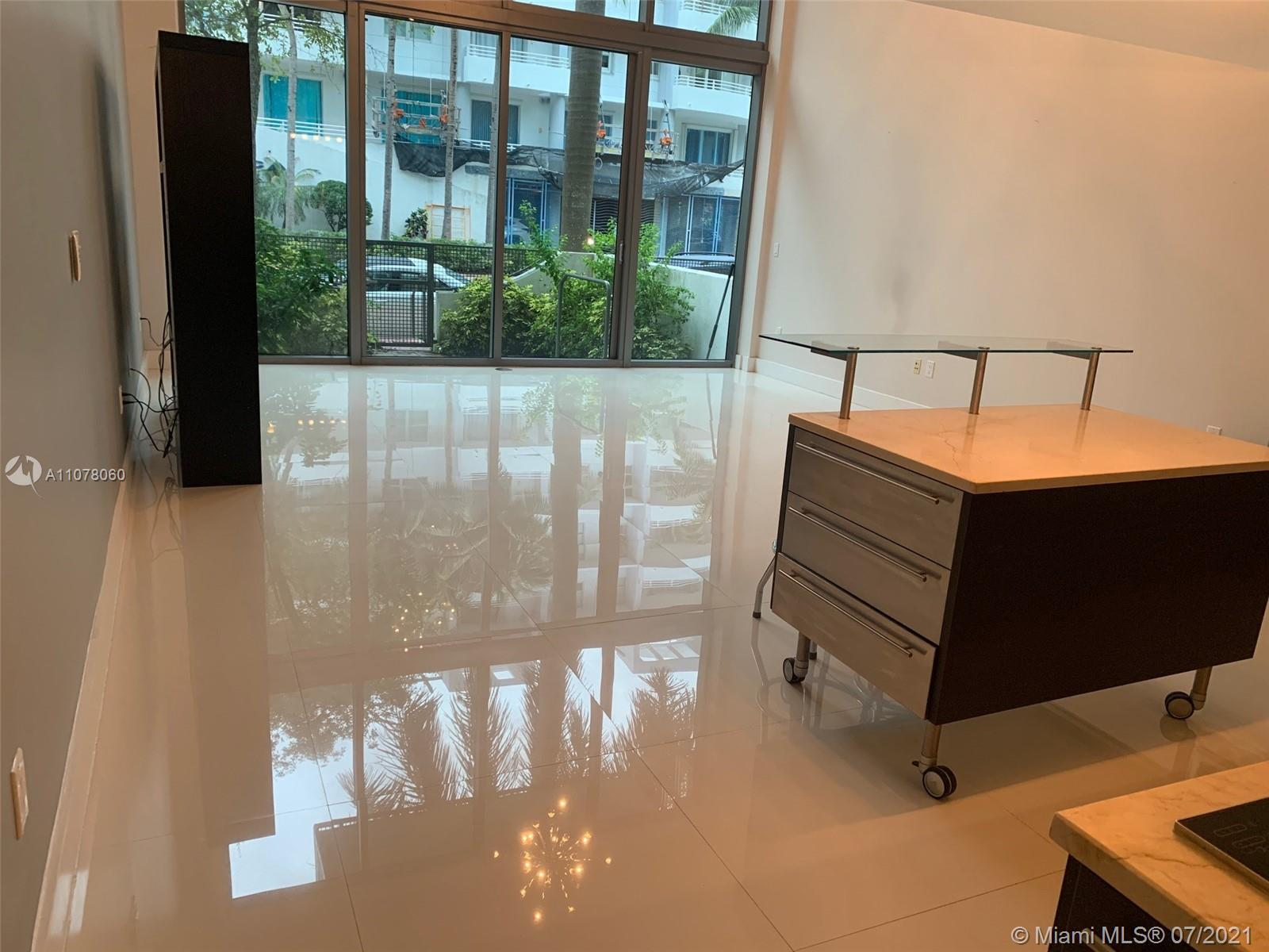 Spacious apartment with double ceiling at living room located in the heart of Miami Beach. 1700 Sqf