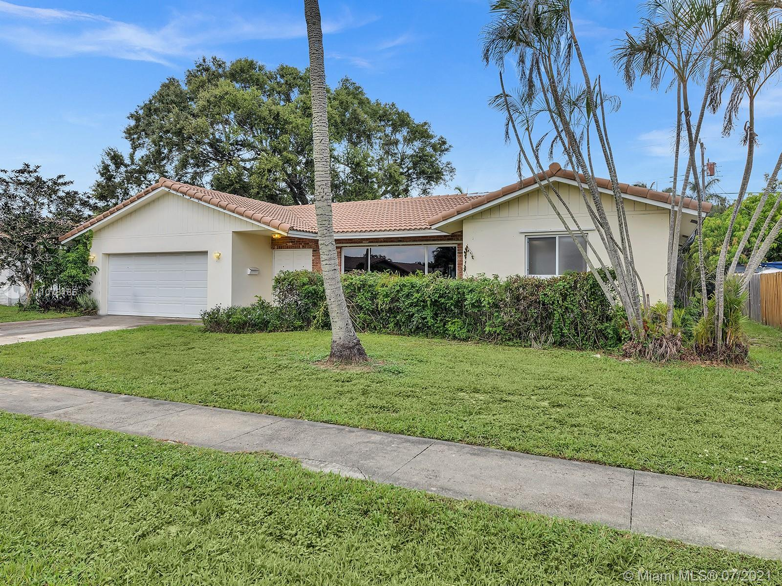 Fantastic opportunity to purchase in this coveted area! Spacious house with a double garage and a po