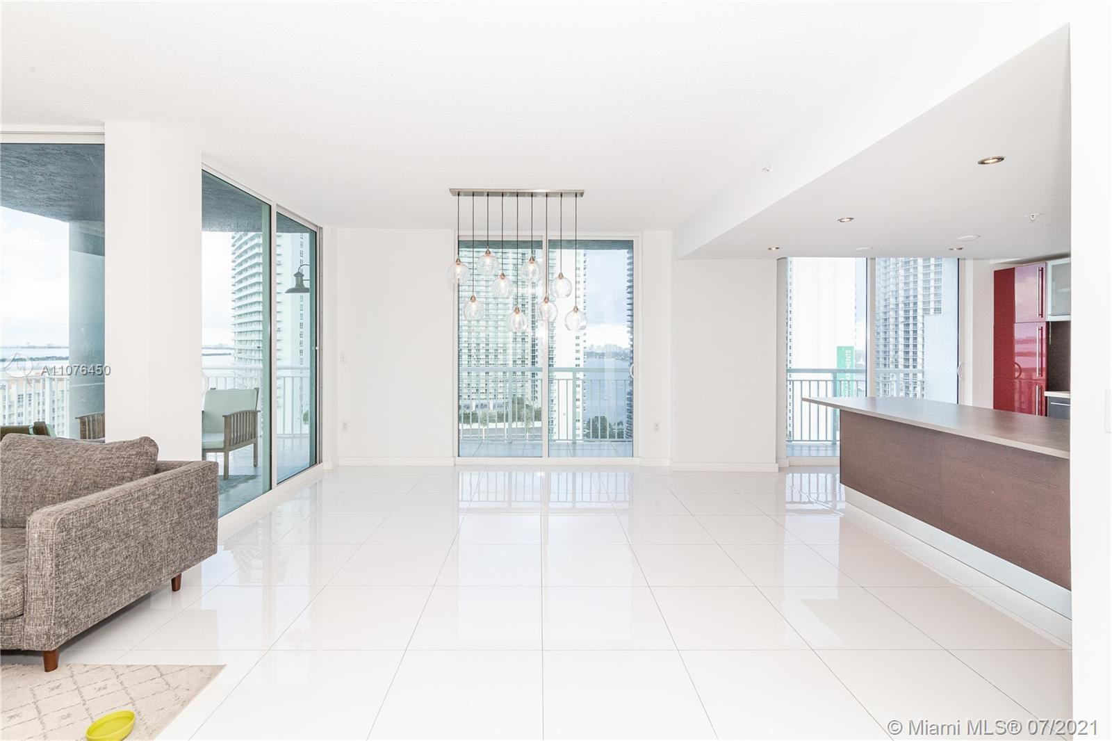 Bay and city views.2-Story Penthouse,3 huge terraces, white ceramic tile, updated kitchen w/high-en