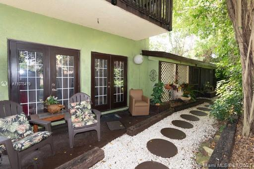 This Rustic Zen home epitomizes indoor-outdoor living w/ 3 decks, several sets of double French door