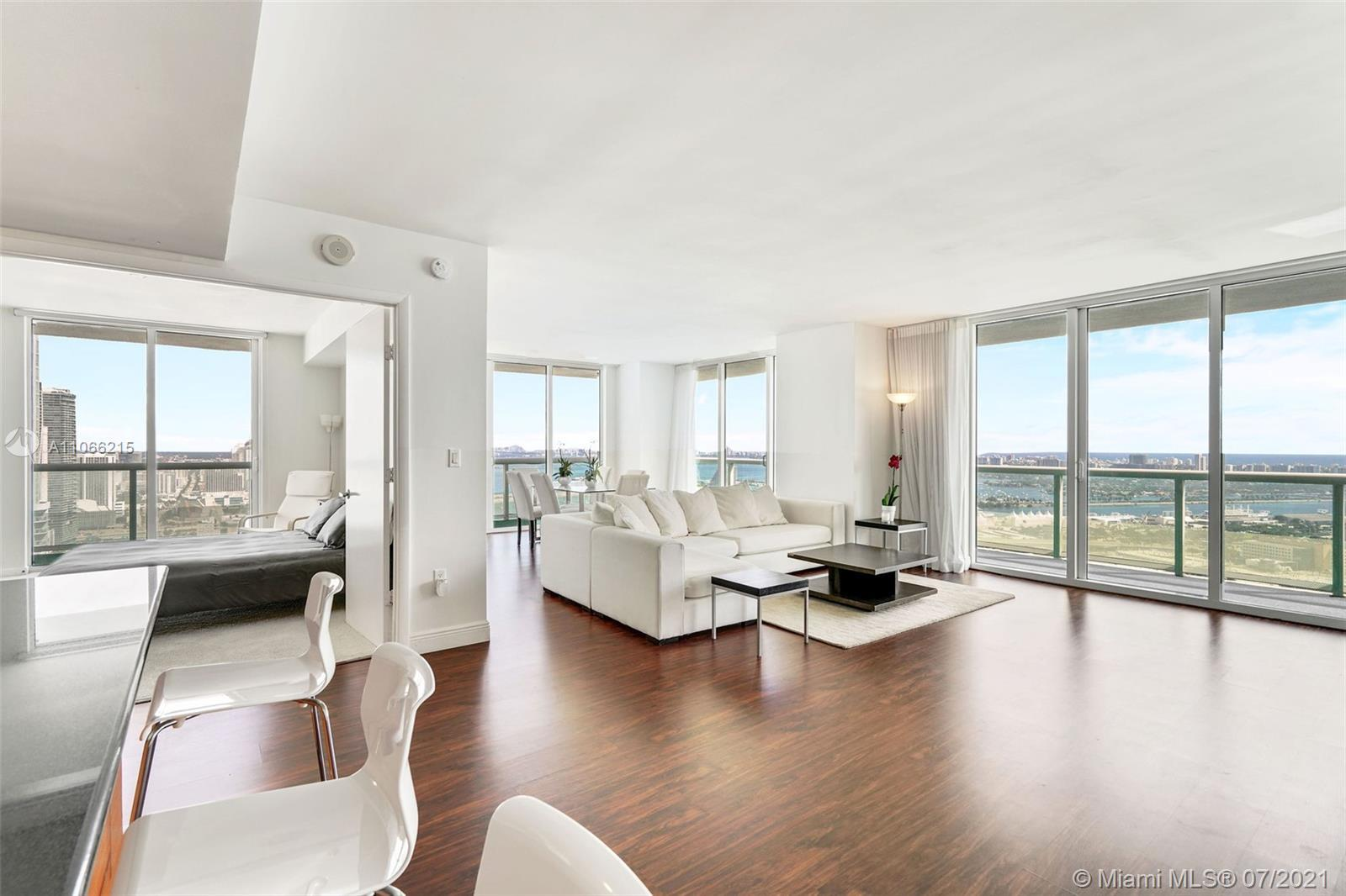Absolutely stunning panoramic views from this spacious 3 bed, 2 bath corner w/wrap around glass balc