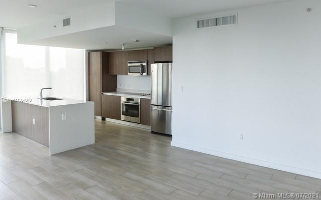 Enjoy great view of Simpson Park, the bay and Brickell Avenue Skyline. This corner unit with 3 bedro