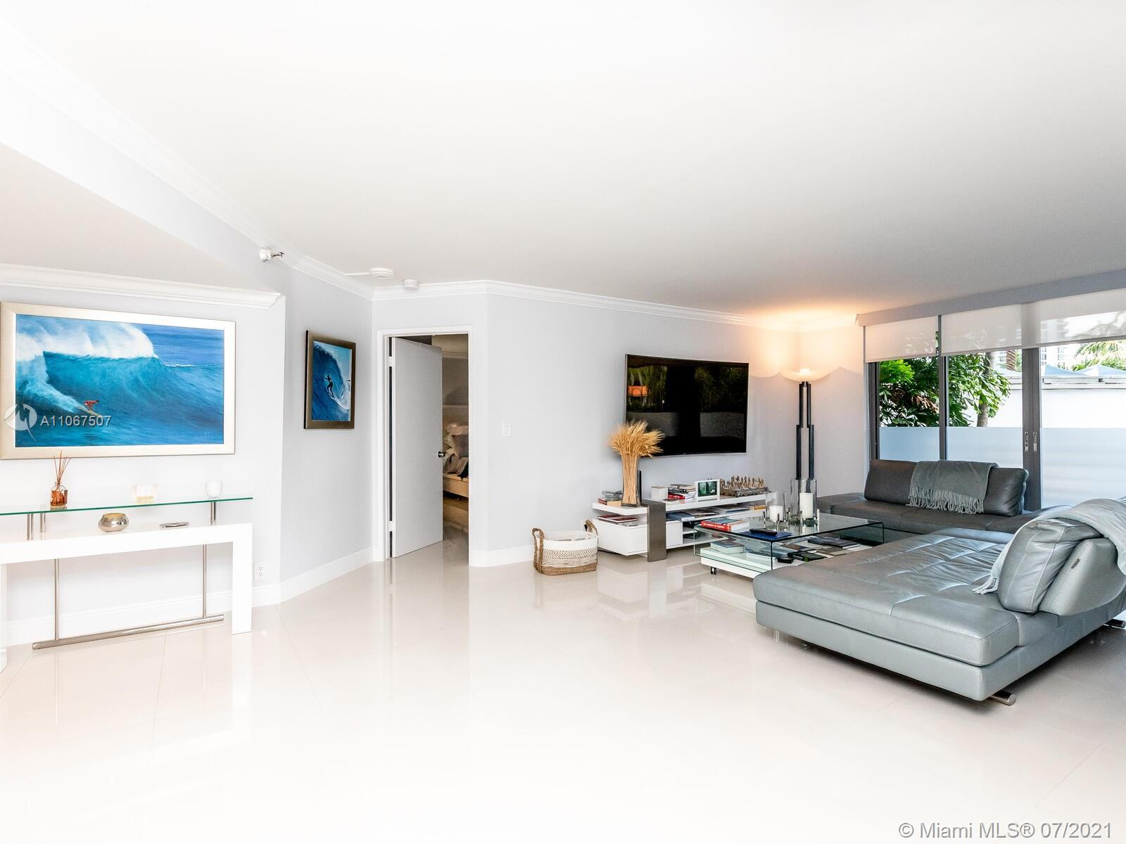 BEAUTIFUL LOCATION CONVERTED TO 3 BEDROOMS WITH 2 FULL BATHROOMS.  NEW PORCELAIN FLOORS.  RENOVATED