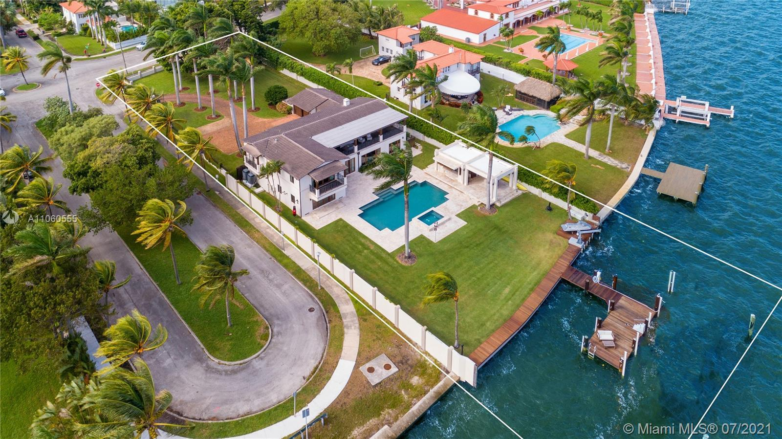 Majestic Estate located in Historic Morningside on a gated 31,100 SF corner lot surrounded by lush g