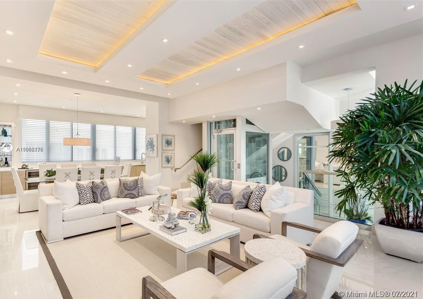 EXCLUSIVE TURN-KEY BEACHFRONT LUXURY TOWNHOUSE! Spanning over 4 stories, this meticulously appointed