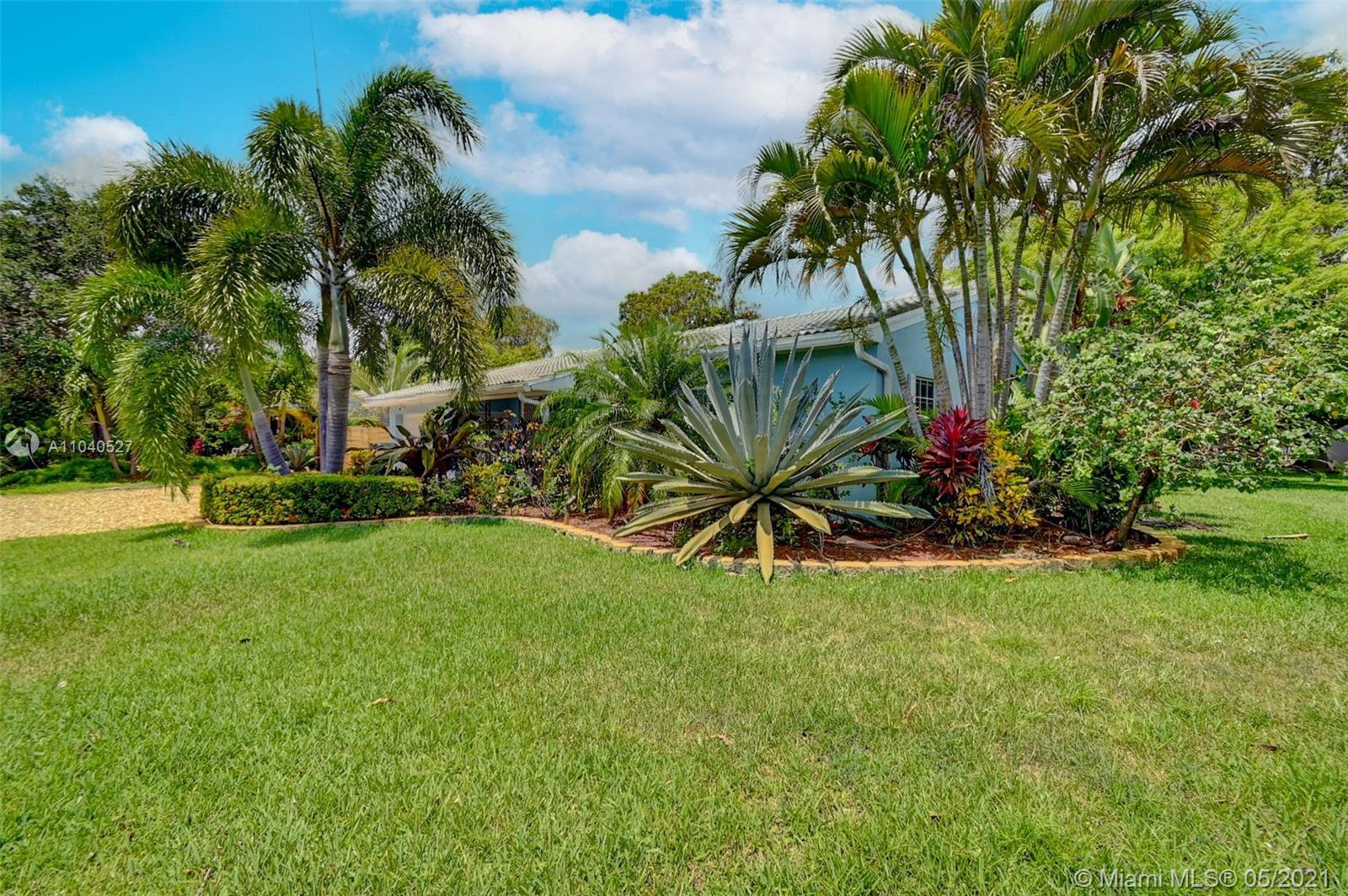 Beautifully remodeled home just minutes from the beach ! Polished Terrazzo floors throughout, brand