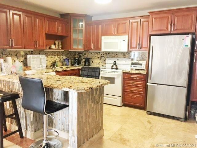 Fully updated large corner 2/2 , open kitchen with quartz counter top, marble floors throughout the