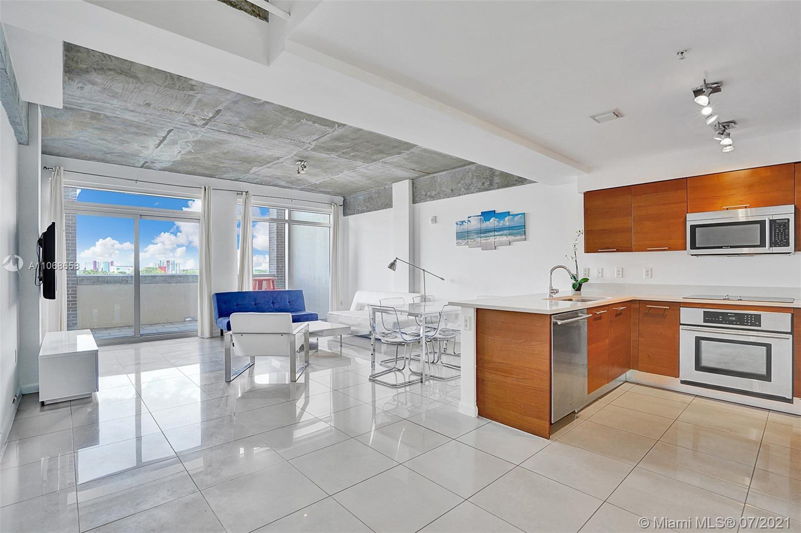 Spacious two story condo at Midblock in Midtown. This chic two bedroom condo boasts porcelain floori