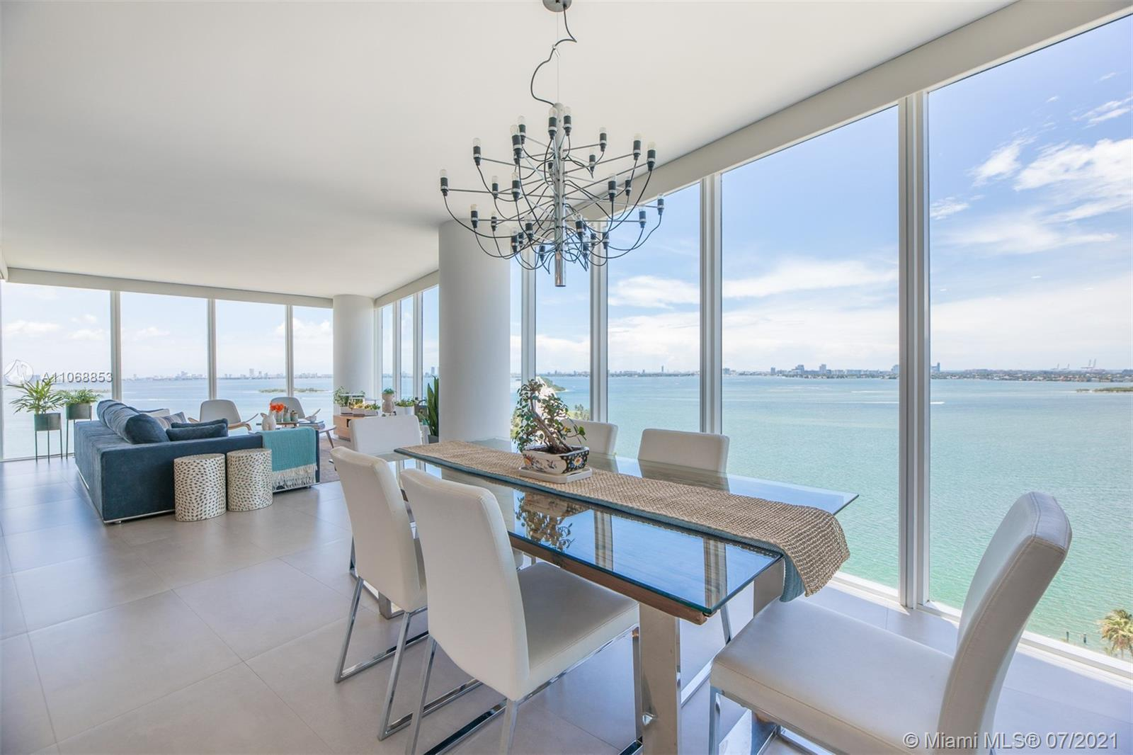Stunning waterfront residence with incredible unobstructed Bay views.  Corner 2 bedroom, large Den &
